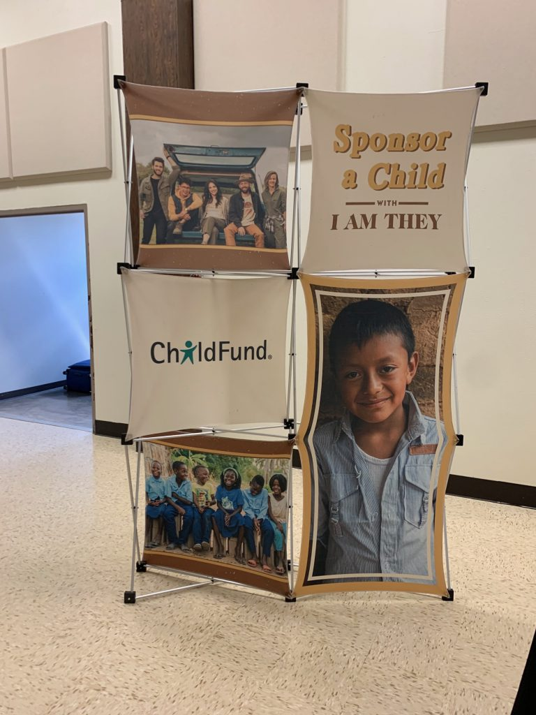 ChildFund sponsor a child display for I AM THEY